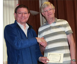 Alastair Taylor presented with certificate by Howard Bagshaw
