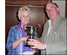 Beryl Slade recieves cup from Gordon Nicklin